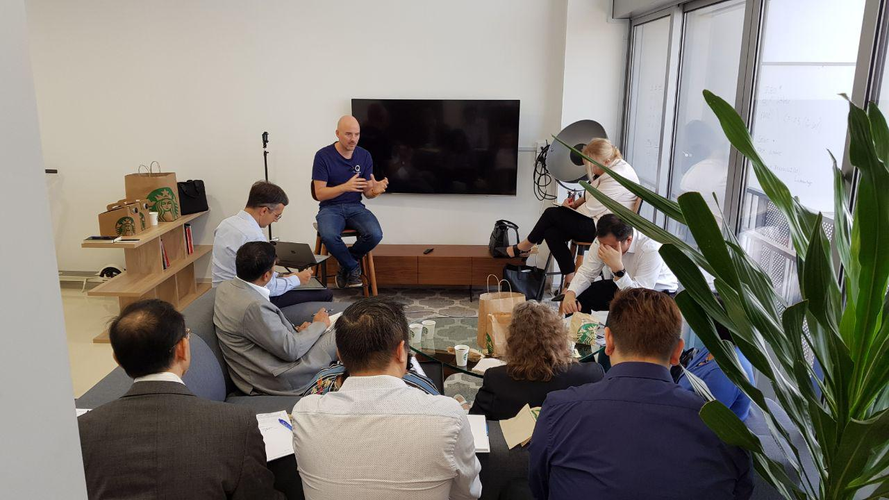 CEO Mike Davie discussing with the students from Murdoch